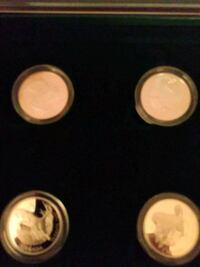 Stirling silver coin set 1997 4 capsule silver dog coins both sets r