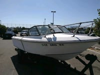 Fishing boat on trailer completely open has captains chair