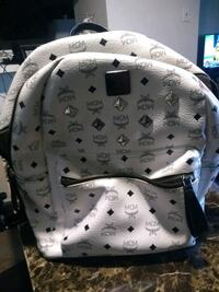 white and black MCM leather backpack Alaska