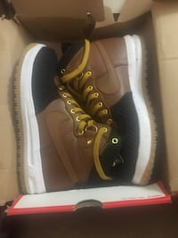 pair of brown-and-black Air shoes