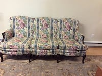Black wooden framed pink and green floral fabric sofa