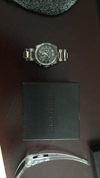 round silver chronograph watch with link bracelet Lower Sackville, B4E 3G1