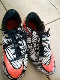 pair of orange-and-black Nike cleats Garland, 75040
