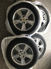 Hankook Tires with Alloy Rims 175/70R14 like new. Used one month OBO