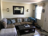 $100 Brown and black sectional couch Saint Petersburg, 33703