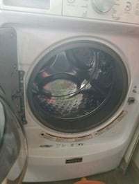 white front-load clothes washer Raymond, 03077
