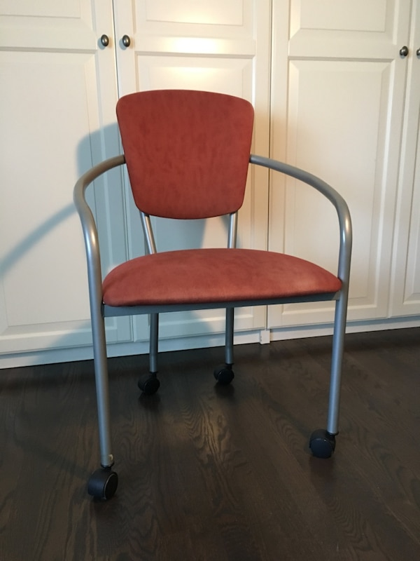 black and red metal armchair
