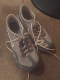 pair of gray-and-white Nike running shoes 1015 mi