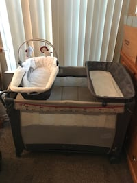 baby's gray and white travel cot North Las Vegas, 89031