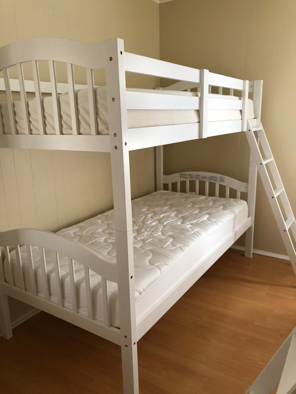 white wooden bunk bed with mattress