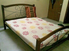 Queen sized wrought iron bed with coir mattress