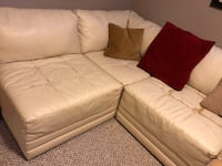white leather tufted sofa with throw pillows Grand Rapids