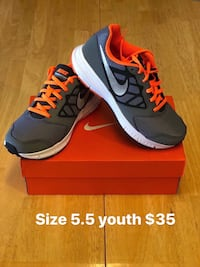 pair of gray-and-red Nike running shoes Sacramento, 95838
