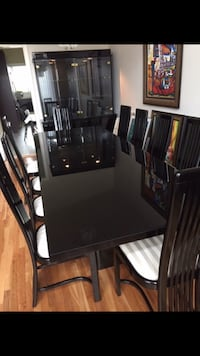 Black lacquered dining table with chairs set