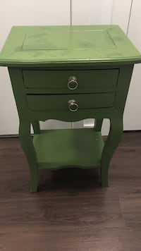 green wooden 2-drawer nightstand