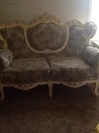 brown wooden framed brown fabric padded sofa 36 mi