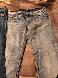 two blue and black denim jeans Langley, V3A 3T9