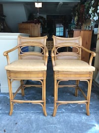 Four like new beautiful rattan and wicker bar chairs