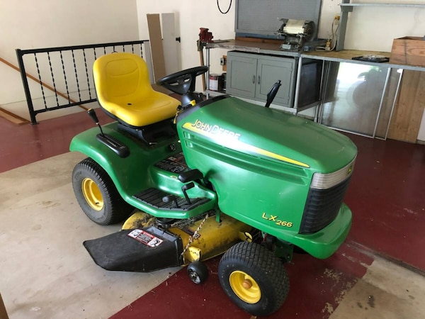 John Deere LX266 Riding Lawn Mower With Cutting Deck, Bagger and Trailer
