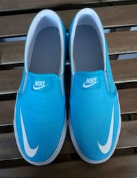 Size 7 Nike woman's Slip on $60
