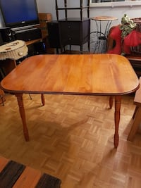 oval brown wooden dining table