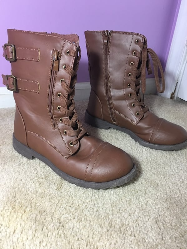 brown leather laced up boots 52bad557-f959-4d02-9f4a-58fd114d13fb