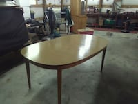 round brown wooden table with two chairs Oklahoma City, 73110