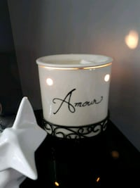 white Amour candle holdr