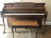 brown wooden framed upright piano WESTBABYLON
