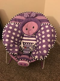 Baby's purple and white polka dot bouncer