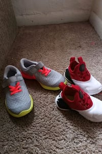 pair of gray-and-red Nike running shoes 1029 mi