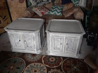 two white wooden side tables