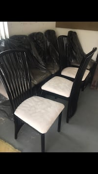 8 black lacquer dining room chairs with cloth seat.  They are off white Walnutport, 18088