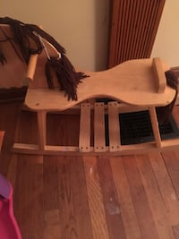 brown wooden rocking chair with white pad 299 mi