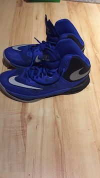 Pair of blue nike basketball shoes Saanich, V8X 3T1