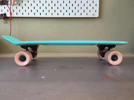 Pink and blue penny board