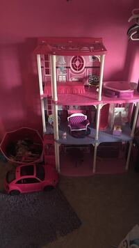 pink, white, and purple plastic doll house
