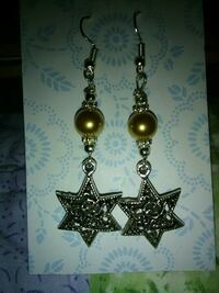 pair of silver-colored star drop hook earrings Inverness
