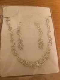 Silver-colored diamond encrusted necklace and drop earrings