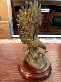 """Brass metal Eagle attached to wood base.  91/4"""" H x 5""""W Ashburn"""