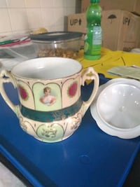 White and green ceramic pitcher
