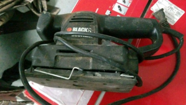 black and red Craftsman corded power tool
