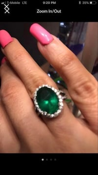 silver-colored ring with green gemstone screenshot Houston, 77039