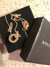 Gold-colored bvlgari chain necklace with round pendant