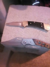 brown and black folding knives
