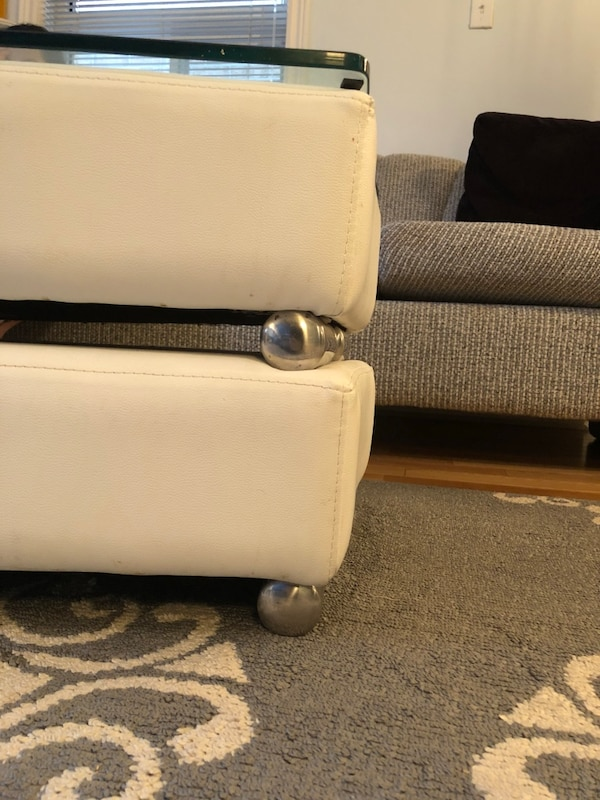 Two white leather ottomans