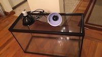 black steel framed fish tank with 2 heating lamps and one UV light bulb. It's 19 x 30 x 12.5 inches