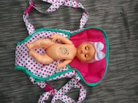 Sound making toy baby doll with Carrier