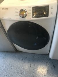 gray and black front-load clothes washer