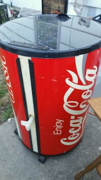 red and white Coca-Cola can 152 mi
